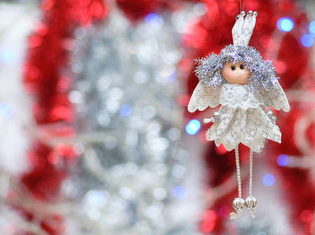 on the shiny, new year background toy handmade white angel Stock Photo - 15959229