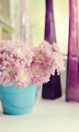 beautiful delicate bouquet of pink chrysanthemums in a blue bucket photo