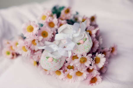 on a white background is a bunch of flowers with beautiful baby booties photo