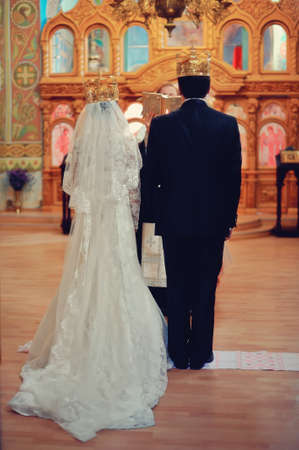 Bride and groom at church wedding altar ceremony photo