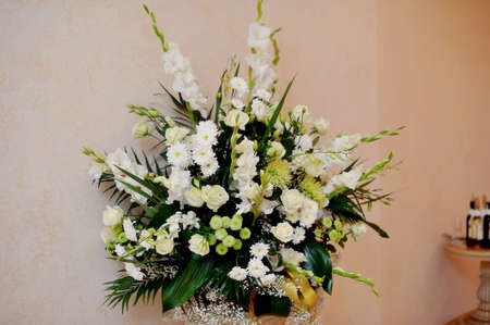 on a beige background of a beautiful bouquet of white flowers Stock Photo - 16627569