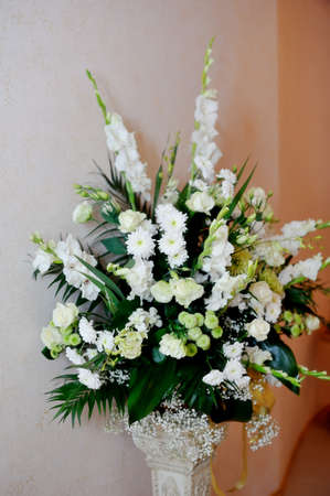 on a beige background of a beautiful bouquet of white flowers photo