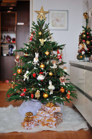 the room is beautiful decorated Christmas tree with gifts under it Stock Photo - 16669203