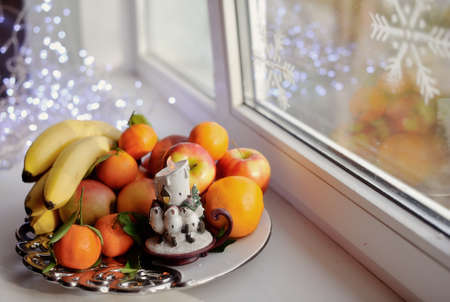 on the window still life fruit on a platter with a candle Stock Photo - 16715904
