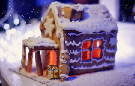 Christmas cake, a small house with snowflakes, and fire in the snow