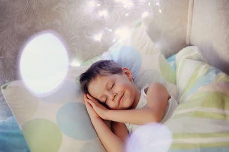 little boy sleeping in a cozy bed child