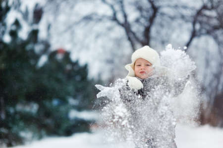 snowy winter outdoors boy playing with snow Stock Photo - 16972266