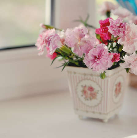 Beautiful fine bouquet of beautiful roses and carnations in a white pot Stock Photo - 17078648