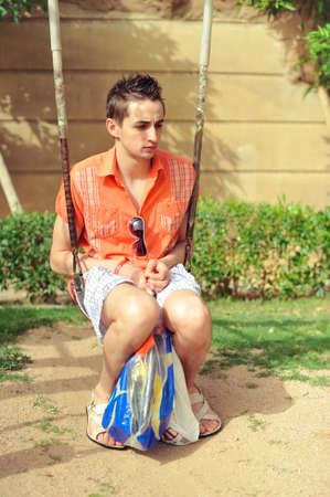 introversion: Adult guy in a baby swing recalls childhood
