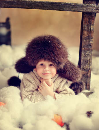 a smiling boy in a fur hat Stock Photo