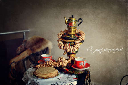 still life on the table is a samovar with bagels and pancakes photo