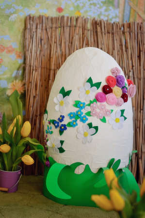 Easter composition, a large white egg decorated with colorful flowers photo
