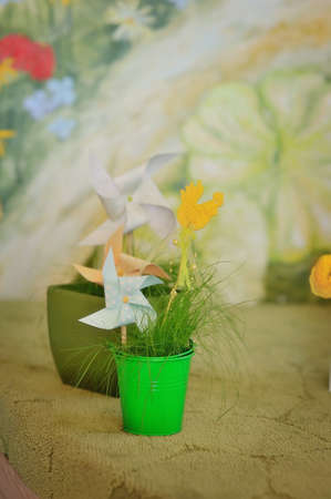 pinwheel toy: Spring composition of bouquets of flowers in vases and a toy pinwheel paper