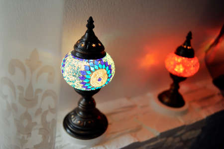 close-up shows two curly, colored patterned lamp in oriental style photo