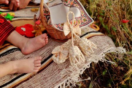 children s feet: Outdoors on linen bedspread children s bare feet