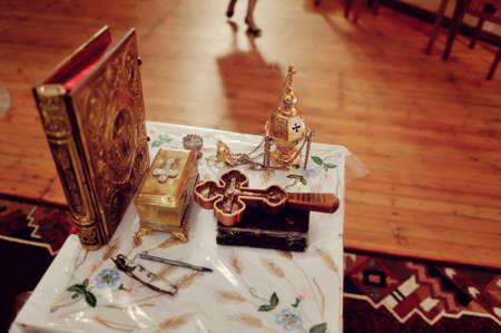 personal god: preparation for the rite of the Bible on the table, cross, lamp and other accessories Stock Photo