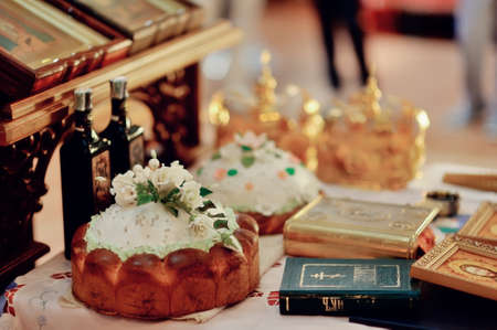accessories for wedding in a church on a table decorated with flowers and a loaf of Bible photo