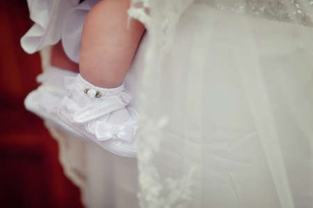 a white dress baby leg in a beautiful white shoes to wear photo