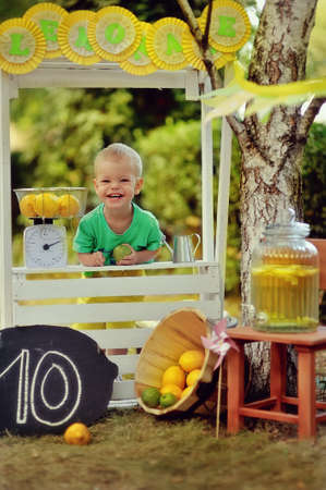 on the nature of the white counter with lemons  boy Stock Photo