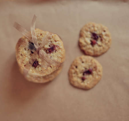 oatmeal cookies on a paper tied with ribbon photo