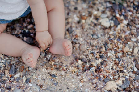 summer on the beach little baby bare feet Stock Photo