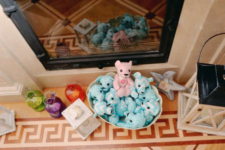 child s block: festive decoration in white and blue colors on the floor with a basket of cloth bears