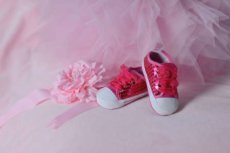 on pink tulle trim red baby shoes with big laces photo