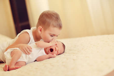 1 2 years: little brother with the sleeping baby