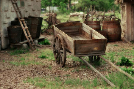 casks: in the courtyard of the house with big old wooden casks cart Stock Photo
