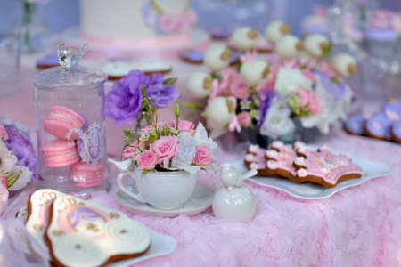 holiday table with delicate decorations, bouquets of flowers and dessert Stock fotó - 43887332