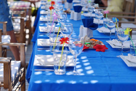 dinner food: banquet table - on a blue tablecloth Glassware sea scenery