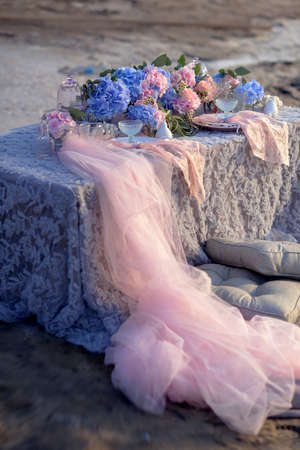guipure: hydrangea flower arrangement on the table with a pink guipure and pillows