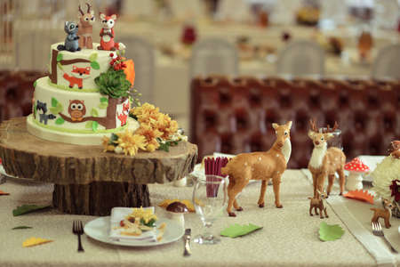 savory: on the holiday table on a wooden deck cake with animals for children