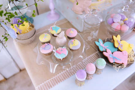 festal: Easter decorations on the table, rabbits and cakes and colored eggs