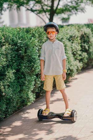 blading: sunny day in the park Boy in helmet rollerblading