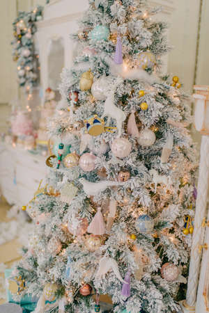 large christmas tree in the snow and lights with different beautiful toys stock photo 69765750