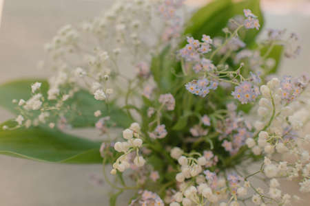 Very delicate, spring bouquet of lilies of the valley and forget-me-nots