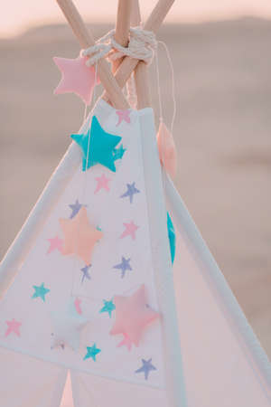 pink vintage wigwam with colorful stars Stock Photo