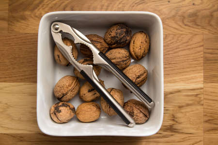 whole pecans: Walnuts and nutcracker