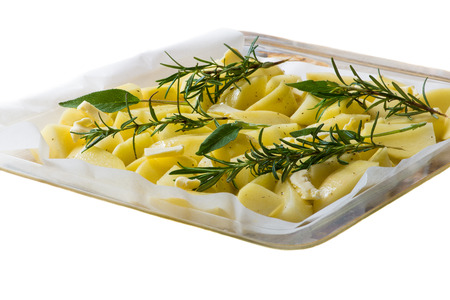 roast potatoes: Roast potatoes to be cooked (ingredients - salt, rosemary, sage, oil, butter, spices) Stock Photo