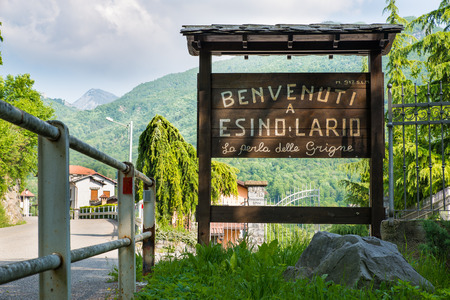 wiki wikipedia: Esino Lario, Italy - May 27, 2016: tourist sign at the entrance of the village. The sign says: Welcome to Esino Lario the pearl of the Grigne. Esino Lario, venue between 21 to 28 June 2016 of the 12th international Wikimedia conference, is a small mount