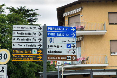 wikipedia: Varenna, Italy - May 27, 2016: road signs in Varenna. We are at the start of the ascent of Esino Lario, venue between 21 to 28 June 2016 of the 12th international Wikimedia conference. Esino Lario is a small mountain village above lake Como Editorial