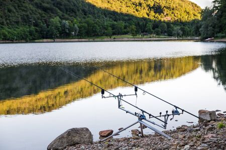sportfishing: Fishing adventure. Carp fishing, fishing rods propped on a rod pod Stock Photo