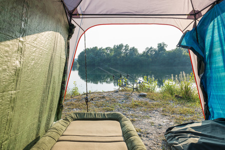 sportfishing: Fishing adventures - Camping equipment and carp Stock Photo