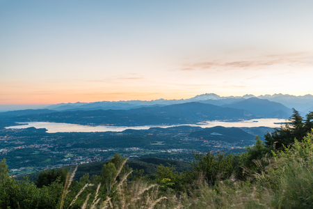 the po valley: Panorama from the Regional Park Campo dei Fiori of Varese, Italy. View towards the Pennine Alps with Monte Rosa at sunset, below you see the Lake Maggiore