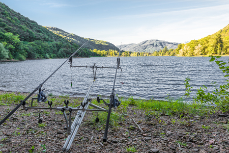 sportfishing: Fishing adventures. Carp rods propped on a rod pod with two bite alarms