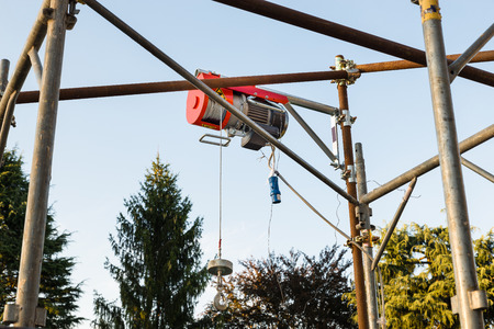 windlass: Industrial equipment: electric rope hoist on a construction site