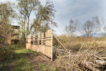 naturalistic: Birdwatching tower and shielding barrier for birdwatching along naturalistic route at the Oasis Brabbia marsh, the provinces of Varese, Italy. Eco tourism