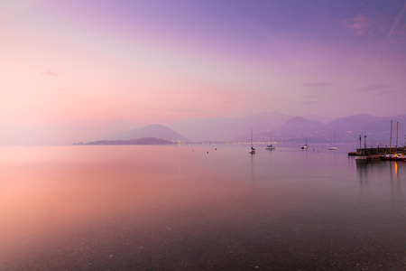 Lake Maggiore, Laveno, Cerro, Italy. Picturesque and romantic sunset on Lake Maggiore from the lakeside of the small village of Cerro. In the background the Piedmont side, between Pallanza and Intra Imagens