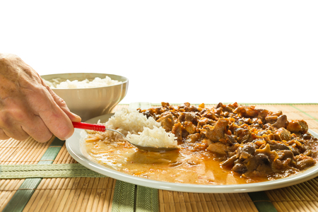 stewing: Stew of pork (loin), honey mushrooms and rice basmati on a white background